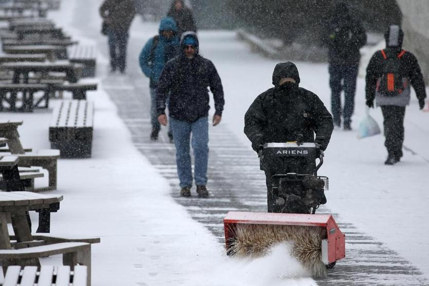 A worker cleared the walkway in front of the Children's Museum.